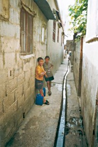 Refugees-street-drain